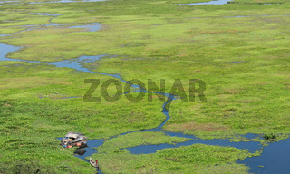green lake and boat - landscape aerial, cambodia