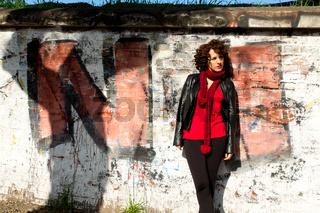 Gorgeous woman posing with graffiti