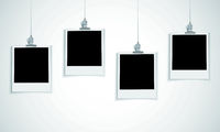 Blank photo frame hanging on a line with clip