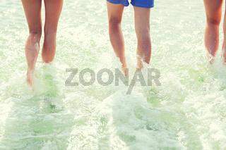 close up of human legs on summer beach