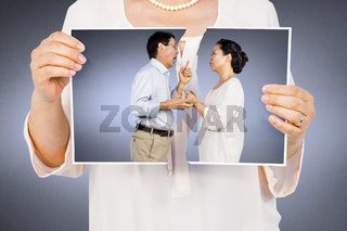 Composite image of woman holding a torn photo