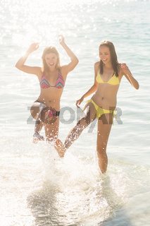 Happy friends having fun in the water together