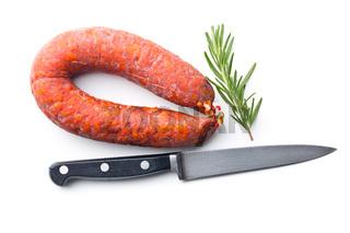 Chorizo sausage, knife and rosemary