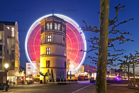 Oldtown, castle tower, in the background the big wheel at evening, Duesseldorf, Germany