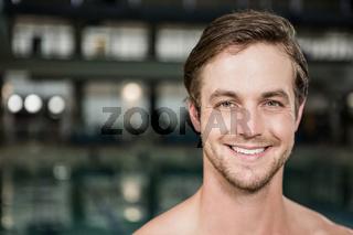 Portrait of swimmer standing near pool