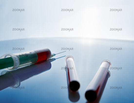 Syringe and vials with blood sampling rear view blue