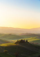 Farmhouse in a tuscany landscape in warm light