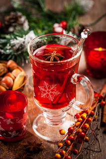 Hot wine punch with ingredients for winter and Christmas