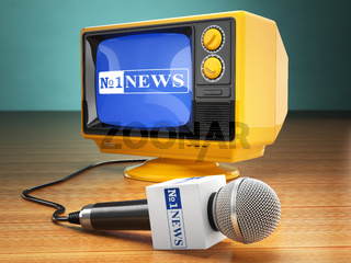 Tv news or report concept. Microphone and television.