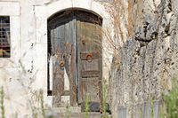 Old wooden door in a stonehouse on Crete