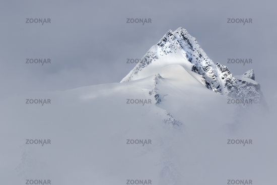 Summit of Mt. Grossglockner with clouds, High Taue