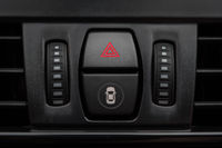 Detail of car interior dashboard with emergency button