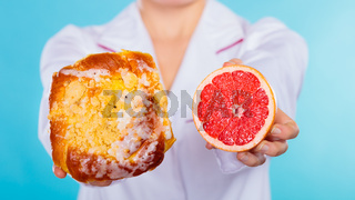 Nutritionist holding a cake and fruit