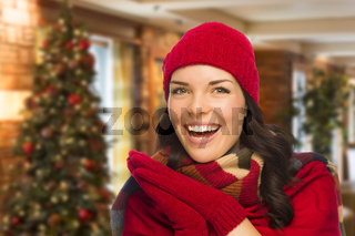Mixed Race Woman Wearing Mittens and Hat In Christmas Setting