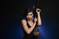 Young athletic woman with gun