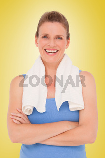 Composite image of fit woman with towel on shoulders