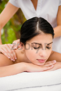 Attractive woman receiving back massage