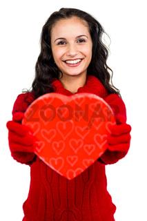 Smiling woman holding heart shape box
