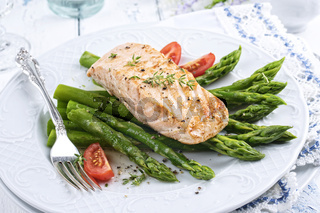 green asparagus with salmon fillet