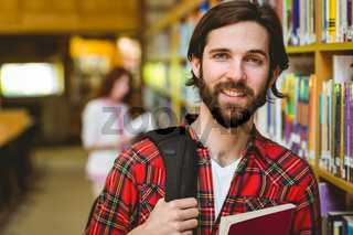 Smiling student in the library