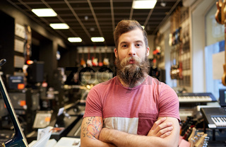 assistant or customer with beard at music store