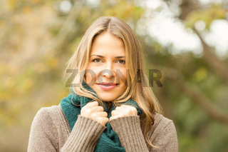 Smiling woman holding her scarf