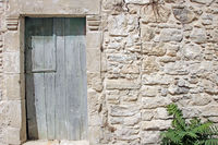 Old wooden door in stonehouse on Crete