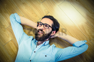 Handsome hipster lying and smiling