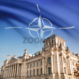 Reichstag building in Berlin with flag on background - NATO