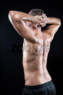 Shirtless muscular athlete standing