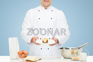 close up of happy male chef cook baking dessert