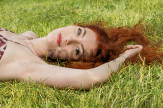 Happy Woman Lying on Grassy Ground