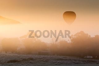 Hot Air Balloon Rises Thru The Mist
