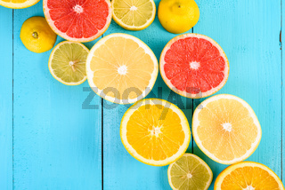 Lemon, Orange, Grapefruit And Lime Citrus Fruit Slices On Turquoise Table
