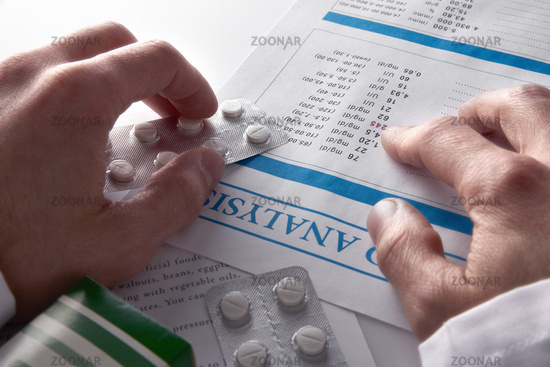 Doctor prescribing drugs and showing blood test report elevated view