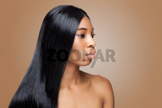 Beautiful young black woman with long straight hair