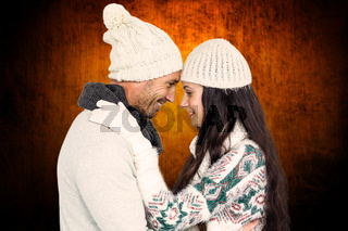Composite image of smiling couple hugging and looking at each other