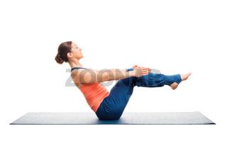 Sporty fit woman doing Ashtanga Vinyasa yoga asana Paripurna nav