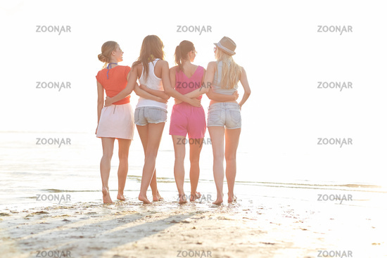group of young women walking on beach