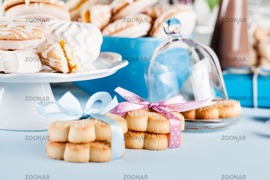 Composition in white and blue with candies, cookies and chocolate milk shake