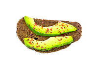Sandwich with avocado and spices on top