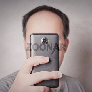 man taking picture with smart phone
