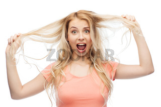 woman holding strand of her hair