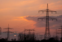 Sunset with electricity masts