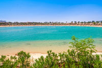 Landscape of tropical beach in lagoon with palm trees Egypt