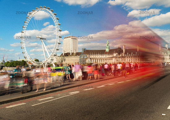 Bus passing tourists and London Eye, London, UK, United Kingdom