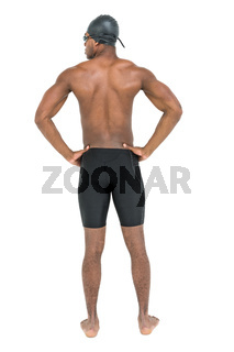 Rear view of swimmer on white background