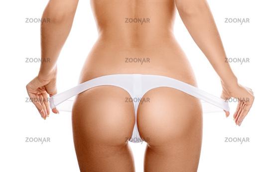 Perfect female sexy buttocks in white lingerie.