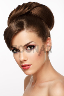 Portrait of the beautiful young girl with elegant hairstyle