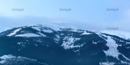 Panoramic image of snowy Carpathian mountains